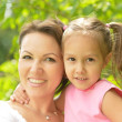 Little cute girl with her mother — Stockfoto