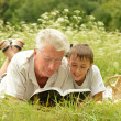 Grandfather and his grandson — Stock Photo #36627775