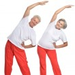 Elderly couple in a gym — Stock Photo #36627917