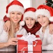 Mom and children in santa hats — Stock Photo