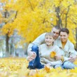 Happy family in park — Foto de Stock