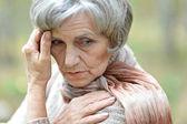 Pensive elderly woman — Stock Photo