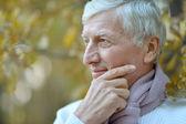 Old man at nature — Stock Photo