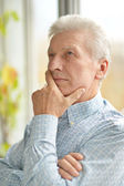 Caucasian elderly man at home — Stock Photo
