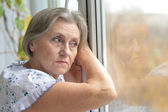 Adorable old woman is resting at home — Stock Photo