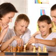Family at the chess — Stock Photo