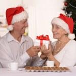 Mature couple celebrating new year — Stock Photo
