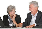 Mature couple in the workplace on a white background — Stock Photo