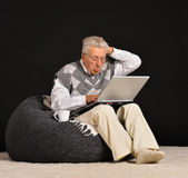 Elderly man with laptop — Stock Photo