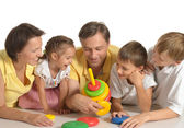 Cute family of a five playing on white — Stock Photo