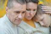 Sad family of three on the nature — Foto Stock
