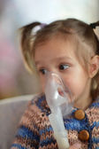 Little girl with inhaler — Stock Photo