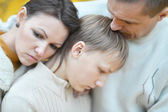 Sad family of three on the nature — Stock Photo