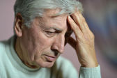 Elderly man thinking — Stock Photo