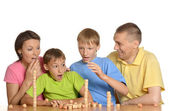 Happy family playing at table — Stock Photo