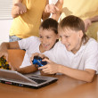 Kids playing video games on notebook — Stock Photo