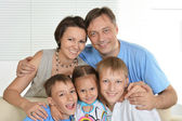 Nice family of a five sitting at home — Stock Photo