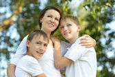 Mom on a walk with her kids in summer — Stock Photo