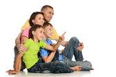 Frendly family on the floor on white background — Stock Photo