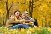 Pretty happy family for a walk in the park fall — Stock Photo