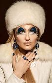 Beautiful woman with artistic make-up posing — Stock Photo