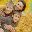 Happy family in the autumn park — Stock Photo
