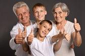 Fun family with thumbs up — Stock Photo