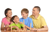 Happy family playing lotto — Stock Photo