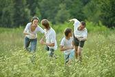 Family having fun in park — Stock Photo