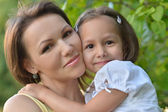 Little cute girl with her mother — Stock Photo