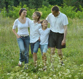 Family walking in park — Stock Photo