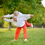 Senior couple exercising in park — Stock Photo #39656417