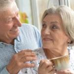 Elderly couple drinking tea — Stock Photo #39656435