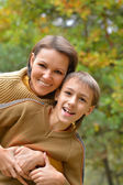 Mother with her son in the park — Stock Photo