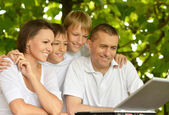 Happy family in summer park — Stock Photo