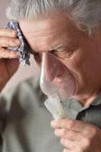 An old man doing inhalation — Stock Photo