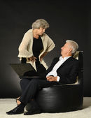 Senior couple working with notebook — Stock Photo