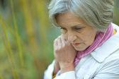 Beautiful elderly woman at nature — Stock Photo