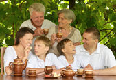 Happy family in summer park — Stock Photo