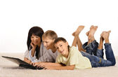 Happy family at home with laptop — Stock Photo