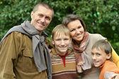 Happy family in the autumn park — Stock Photo