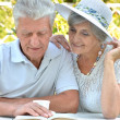 Beautiful older couple resting in the garden — Stock Photo