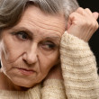 Stock Photo: Thoughtful sad elderly woman