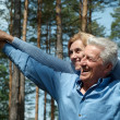 Stock Photo: Older people surrounded by nature