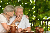 Beautiful Mature couple drinking tea outside — Stok fotoğraf