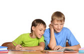 Mother helping children with their homework — Stock Photo