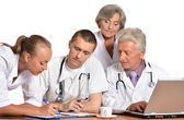 A group of doctors discussing at the table — Stock Photo