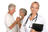 Elderly patients couple came to visit a young doctor — Stock Photo