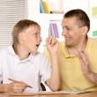Son draws with father — Stock Photo