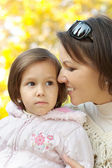 Woman with her little daughter outdoors — Stock Photo